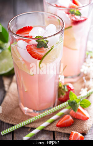 Homemade strawberry lime pink lemonade in tall glasses - Stock Photo