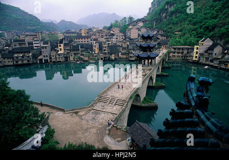 The ancient town of Zhenyuan in China's Guizhou Province with its Ming dynasty Zhusheng Bridge viewed from the Black - Stock Photo