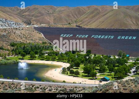 Face of the Lucky Peak Dam and Sandy Point Park on the Boise River near Boise, Idaho, USA. - Stock Photo