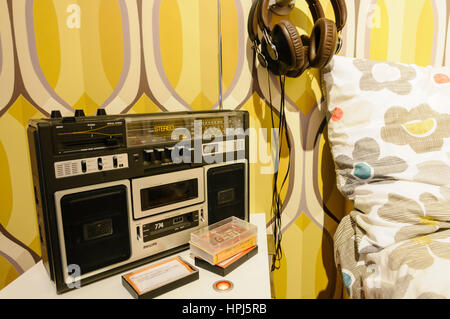 Cassette player in a bedroom from the 1980s. - Stock Photo