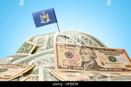 The national flag of New York sticking in a pile of american dollars.(series) - Stock Photo