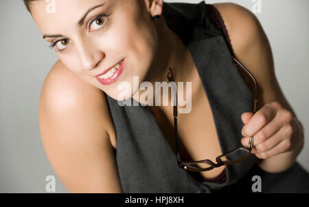 Model released , Junge, attraktive Frau mit Brille in der Hand - young woman with glasses in hand - Stock Photo