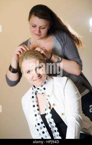 Model released , Hairstylistin - hairstylist - Stock Photo