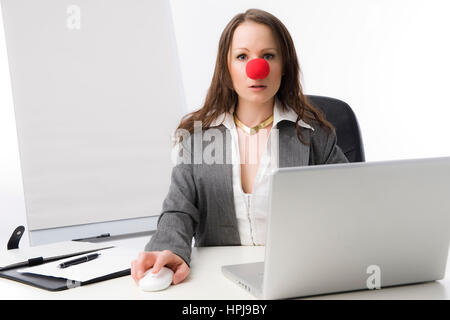 Model released , Geschaeftsfrau mit roter Clownnase - business woman with red nose - Stock Photo