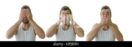 see nothing, hear nothing, say nothing. three men in white shirts - Stock Photo
