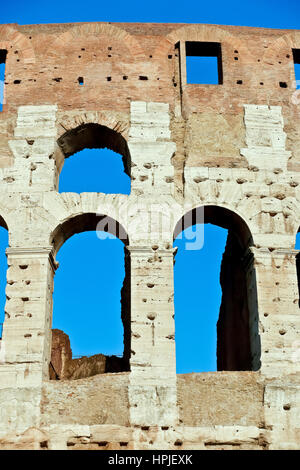 Close up of the exterior of the Roman Colosseum (also known as Flavian Amphitheatre). UNESCO World Heritage Site. - Stock Photo