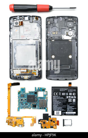 Disassembled smartphone with different electronic parts and lithium ion battery - Stock Photo