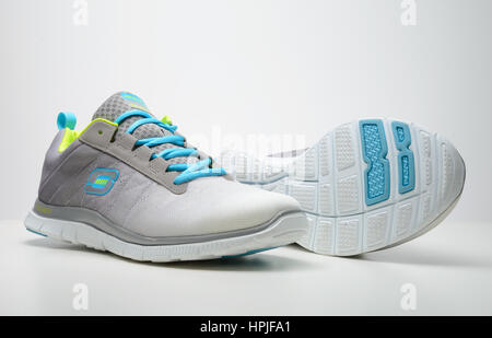 Pair of Skechers running shoes cut out isolated on white background - Stock Photo