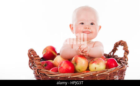 Model released , Baby, 10 Monate, im Apfelkorb - baby in a basket full with apples - Stock Photo
