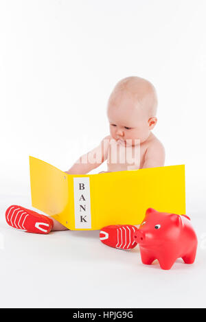 Model released , Baby, 10 Monate, mit Bankbelegen - baby with bank accounts - Stock Photo