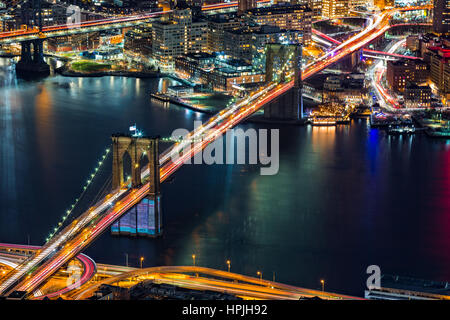 Aerial view of Brooklyn Bridge by night, in New York City - Stock Photo