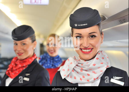 Air Serbia: national airline of Serbia, flight attendants smiling and as they pose for camera in Airbus A330 wide - Stock Photo
