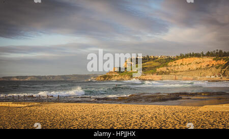 Newcastle beach view at sunrise - Stock Photo