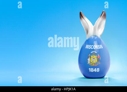 Colorful cute ceramic easter egg with rabbit ears and the flag of Wisconsin .(series) - Stock Photo