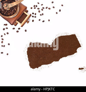 Coffee powder in the shape of Yemen and a decorative coffee mill.(series) - Stock Photo
