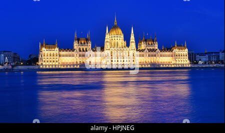 Budapest parliament at blue hour near the Danube river - Stock Photo
