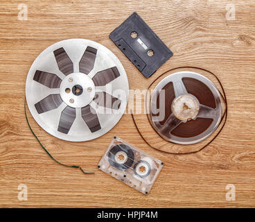 cassettes tape and reel lying on the floor closeup - Stock Photo