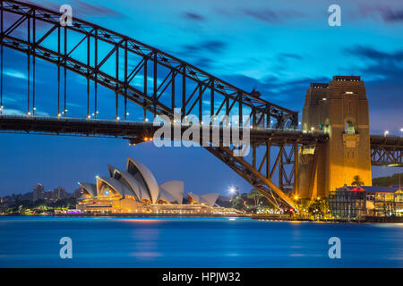 Sydney. Cityscape image of Sydney Opera House, Australia with Harbour Bridge and Sydney skyline during sunset. - Stock Photo