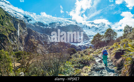 Hiker on trail, Rob Roy Glacier, Mount Aspiring National Park, Otago, Southland, New Zealand - Stock Photo