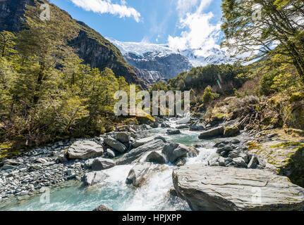 Glacial river flowing through mountains, Rob Roy Glacier, Mount Aspiring National Park, Otago, Southland, New Zealand - Stock Photo