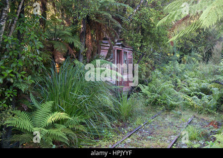 Greymouth, West Coast, New Zealand. Overgrown railway track at Shantytown, recreation of a 19th century gold-mining - Stock Photo