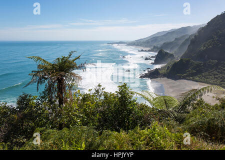 Punakaiki, Paparoa National Park, West Coast, New Zealand. View over coastline from hillside above Meybille Bay, - Stock Photo