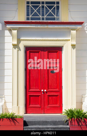 Hokitika, West Coast, New Zealand. Colourful front door of the former Bank of New Zealand building in Revell Street. - Stock Photo