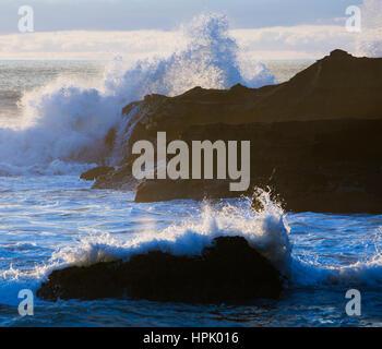 Punakaiki, Paparoa National Park, West Coast, New Zealand. Powerful waves from the Tasman Sea crashing onto rocks. - Stock Photo