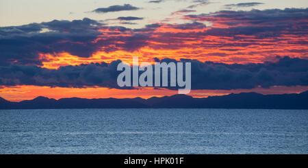 Marahau, Tasman, New Zealand. Panoramic view across Tasman Bay to the Nelson coastline and hills of the Bryant Range, - Stock Photo