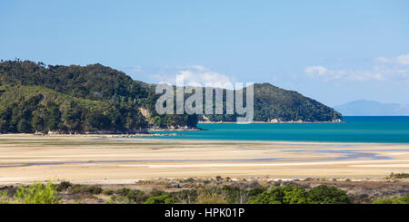 Marahau, Tasman, New Zealand. Panoramic view at low tide across Sandy Bay to the coastline of Abel Tasman National - Stock Photo