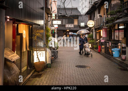 Typical street scene at dusk in Gion District, Kyoto, Japan - Stock Photo