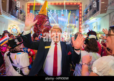 Frank Brunswig dressed as US President Donald Trump greets the audience during the general rehearsal for the Carnival - Stock Photo