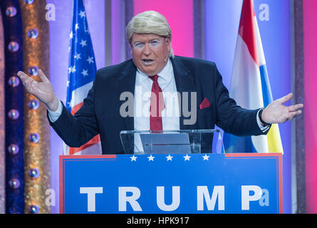 Frank Brunswig dressed as US President Donald Trump gestures during his carnival speech during the general rehearsal - Stock Photo