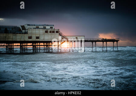 Aberystwyth, Wales, UK. 23rd Feb 2017. UK Weather: A spectacular sunset behind the pier in Aberystwyth after the - Stock Photo