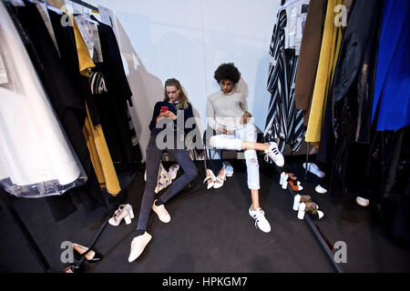Milan, Italy. 23rd Feb, 2017. Models wait backstage before the Anteprima show during Milan Fashion Week Fall/Winter - Stock Photo