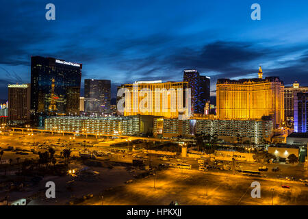 Las Vegas, Nevada, USA - March 22, 2015:  Casino vacation resorts with dusk sky on the Las Vegas strip in Southern - Stock Photo