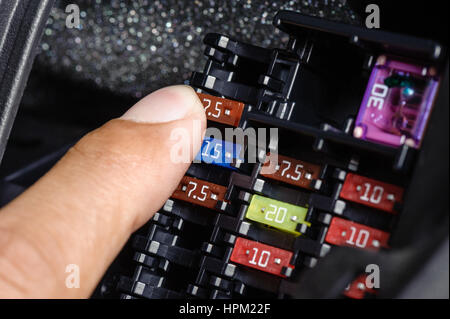 replacing the fuse in fuse box of the car stock photo, royalty How To Fix A Fuse Box In A Car replacing the fuse in fuse box of the car stock photo how to fix a fuse box in a 2003 ford taurus