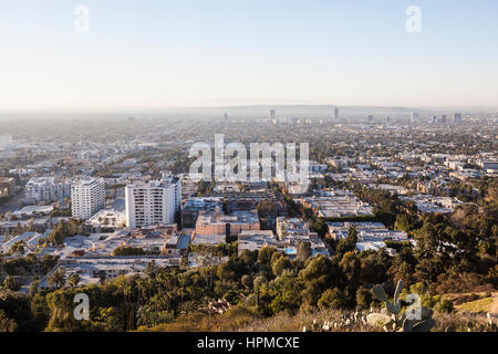 Los Angeles, California, USA - January 1, 2015:  Smog filled morning sky above Hollywood and West Hollywood. - Stock Photo