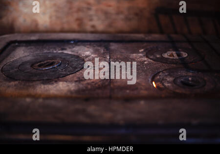 Closeup view of an old metal oven. - Stock Photo