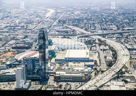 Los Angeles, USA - May 27, 2015: Aerial view of a part of Downtown Los Angeles with the Staples Center and Interstate - Stock Photo