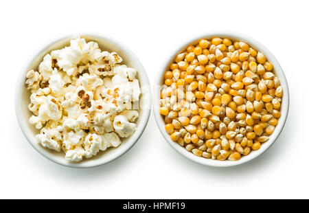 Popcorn and corn seeds in bowl isolaled on white background. - Stock Photo