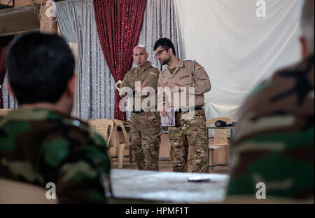 Unidentified Western Medical Volunteer help to train Kurdish forces at a field hospital in the front line town of - Stock Photo