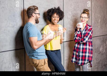 Coworkers having a coffee break - Stock Photo