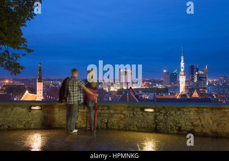 Lookout, panorama, cityscape, Couple,elevated view from viewing platform in Toompea district,Tallinn, Estonia - Stock Photo