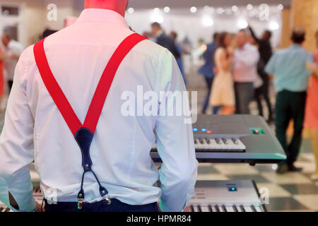 Dancing couples during party or wedding celebration - Stock Photo