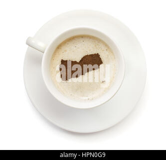 A cup of coffee with foam and powder in the shape of Yemen.(series) - Stock Photo