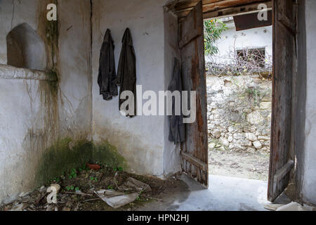 Posessions left inside a house in the abandoned village of Old Theletra, Cyprus - Stock Photo