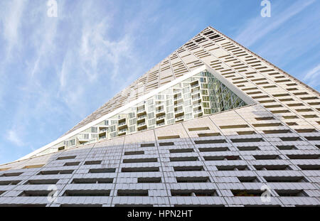 Facade with void of residential courtyard. VI› 57, New York, United States. Architect: BIG Bjarke Ingels Group, - Stock Photo