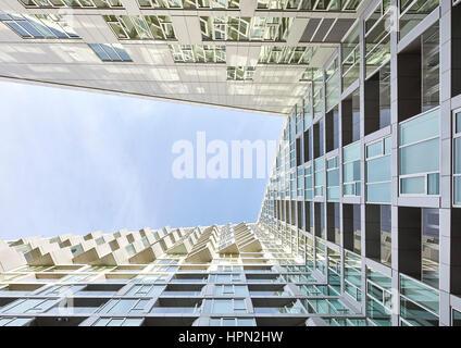 Extreme look upwards along courtyard facade. VI› 57, New York, United States. Architect: BIG Bjarke Ingels Group, - Stock Photo