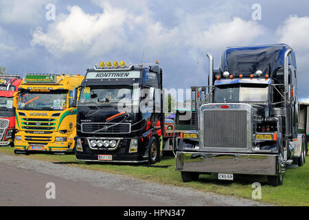 ALAHARMA, FINLAND - AUGUST 12, 2016: Lineup of colorful, new and classic Scania, Volvo and Peterbilt show trucks - Stock Photo